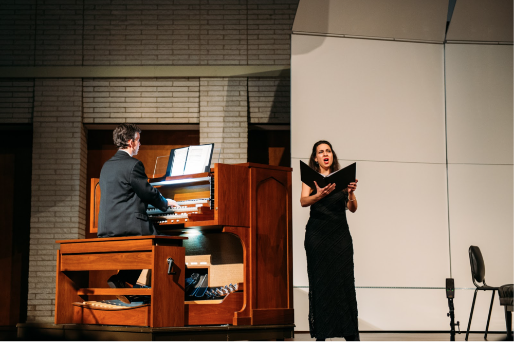 Prof. Beth DuRoy sings a selection as her husband Jason DuRoy plays the organ. (Photo credit: Sophie McClure)