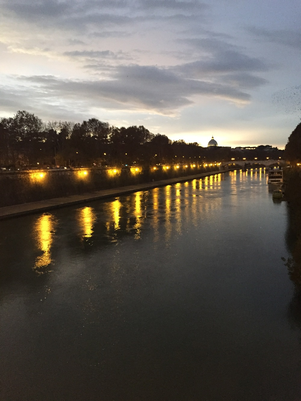 Ponte Sisto at sunset with a view of St.Peters Basilica