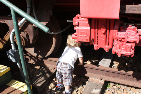 Children LOVE a caboose. This facinated little boy, who would have loved to inspect all details of the caboose, has a watchful mom very close by.