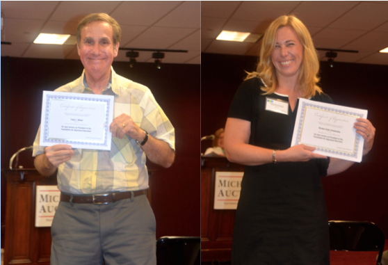 Kirsten Rabe Smolensky and Fred Winer receiving certificates for their service at FAE
