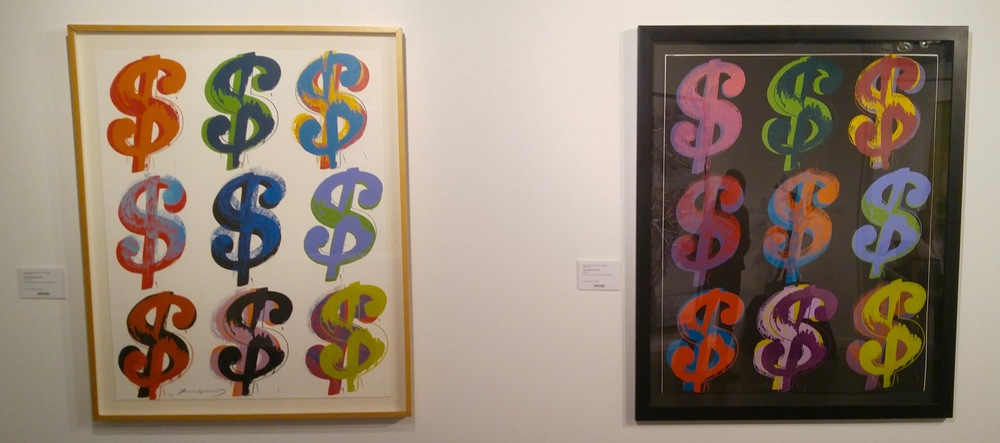 Two Andy Warhol serigraphs on display at the Heritage Auctions booth