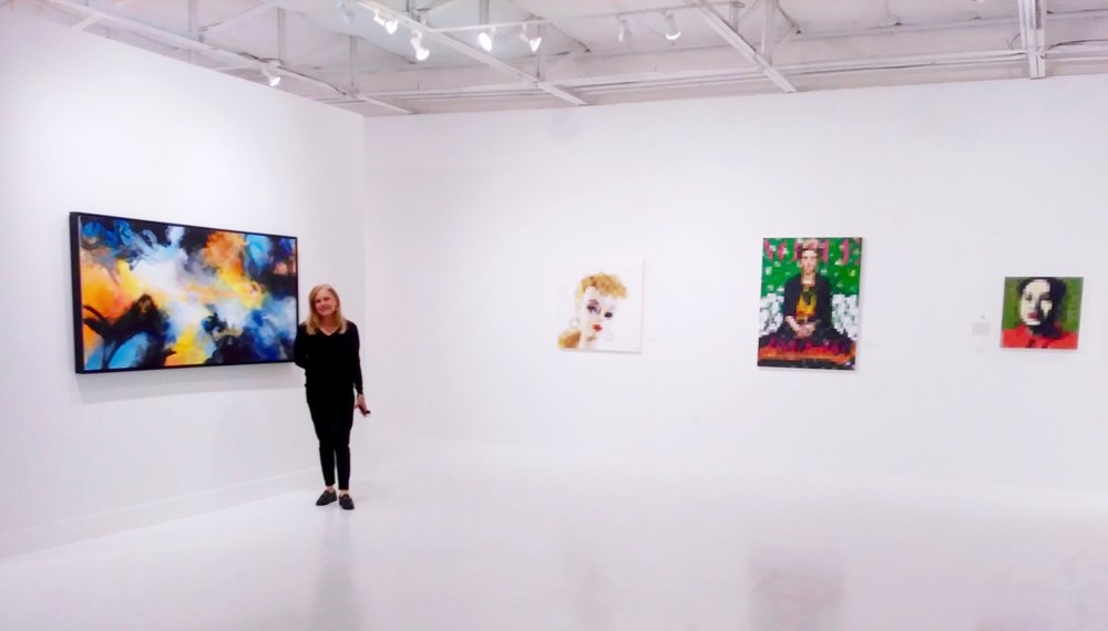Ginger Fox standing in the new gallery space!
