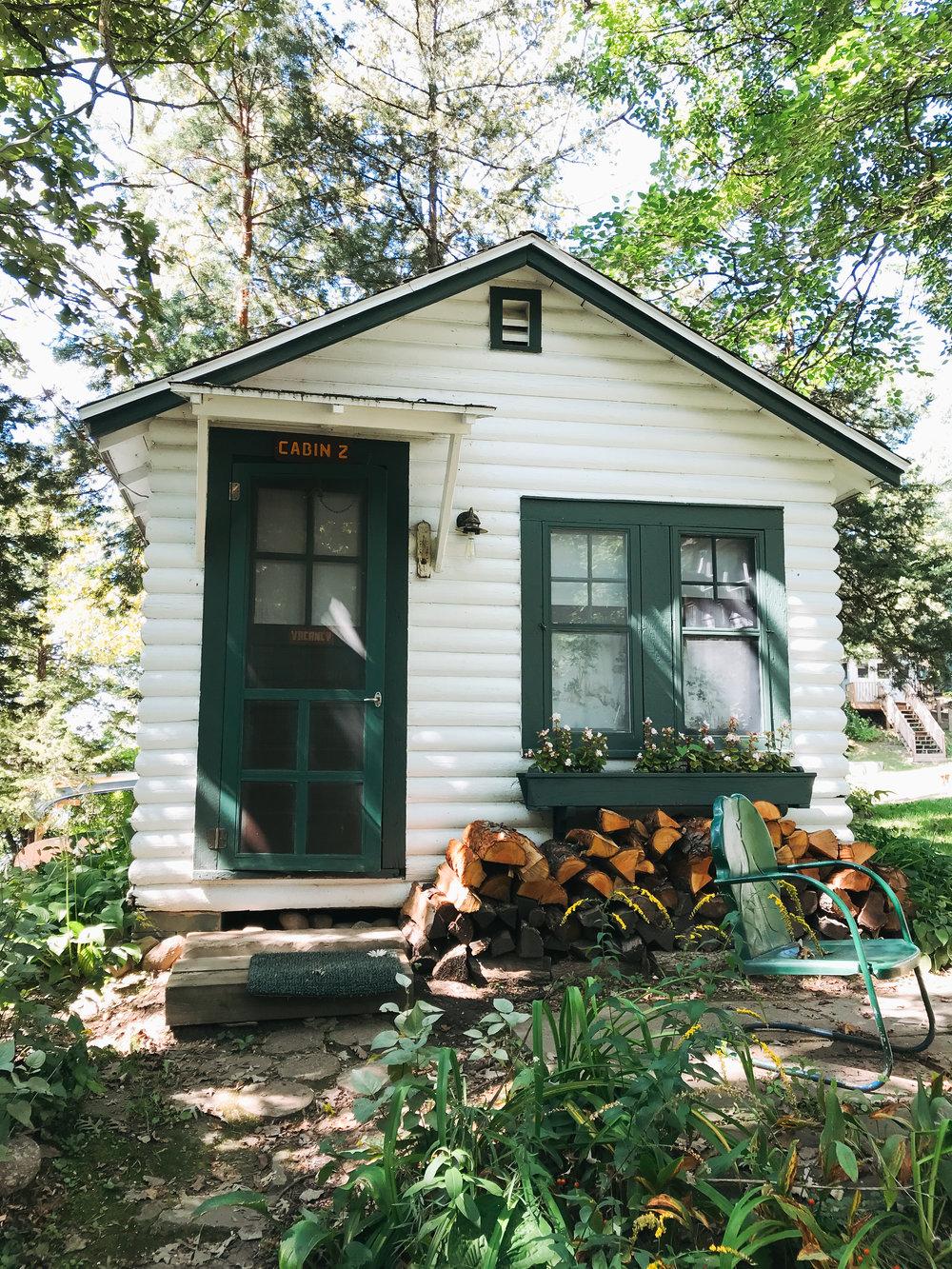 camp_wandawega_cabin_quaint_green_white.jpg