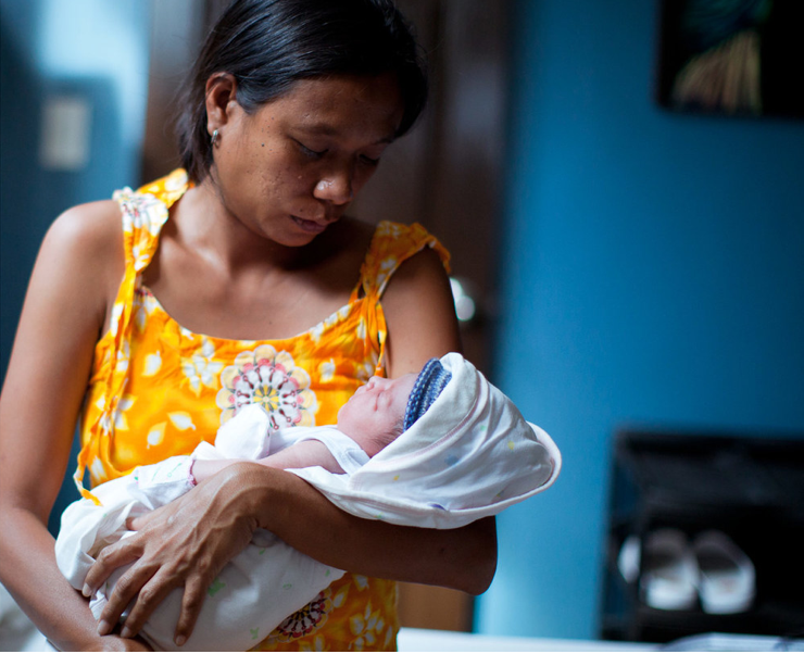 Image courtesy Mercy in Action Inc., one of our partners   A mother holds her child at Mercy in Action Midwifery, Olongapo, Phillippines