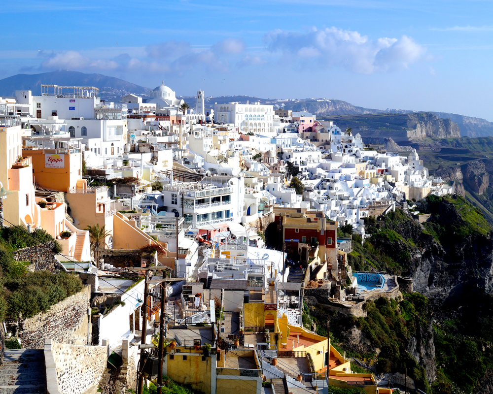 Iconic daytime Santorini and its white walled buildings.