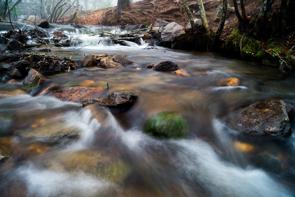 Using a 2-3 second exposure allows me to blur the water as it moves through the scene.