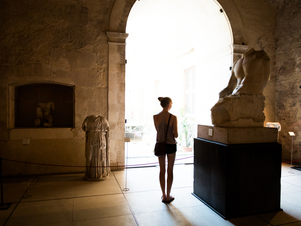 This happened to turn out as a nice photo of Alexis looking at some of the art in the castle.