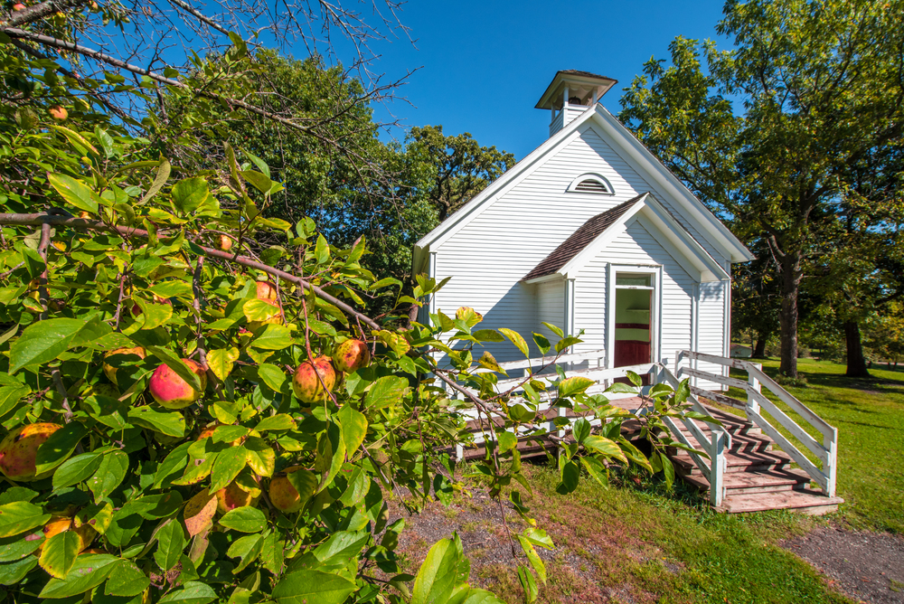 Showing relationship between things like this shot of apples and an old schoolhouse.