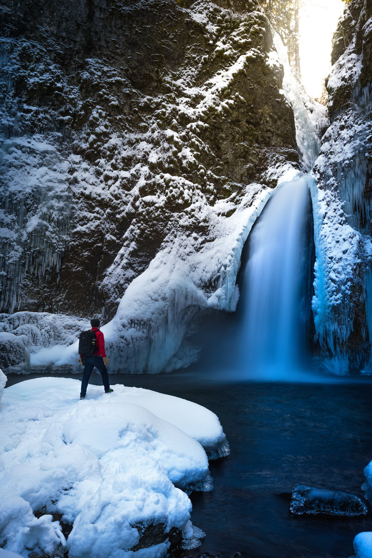 columbia river gorge winter snow waterfall person oregon