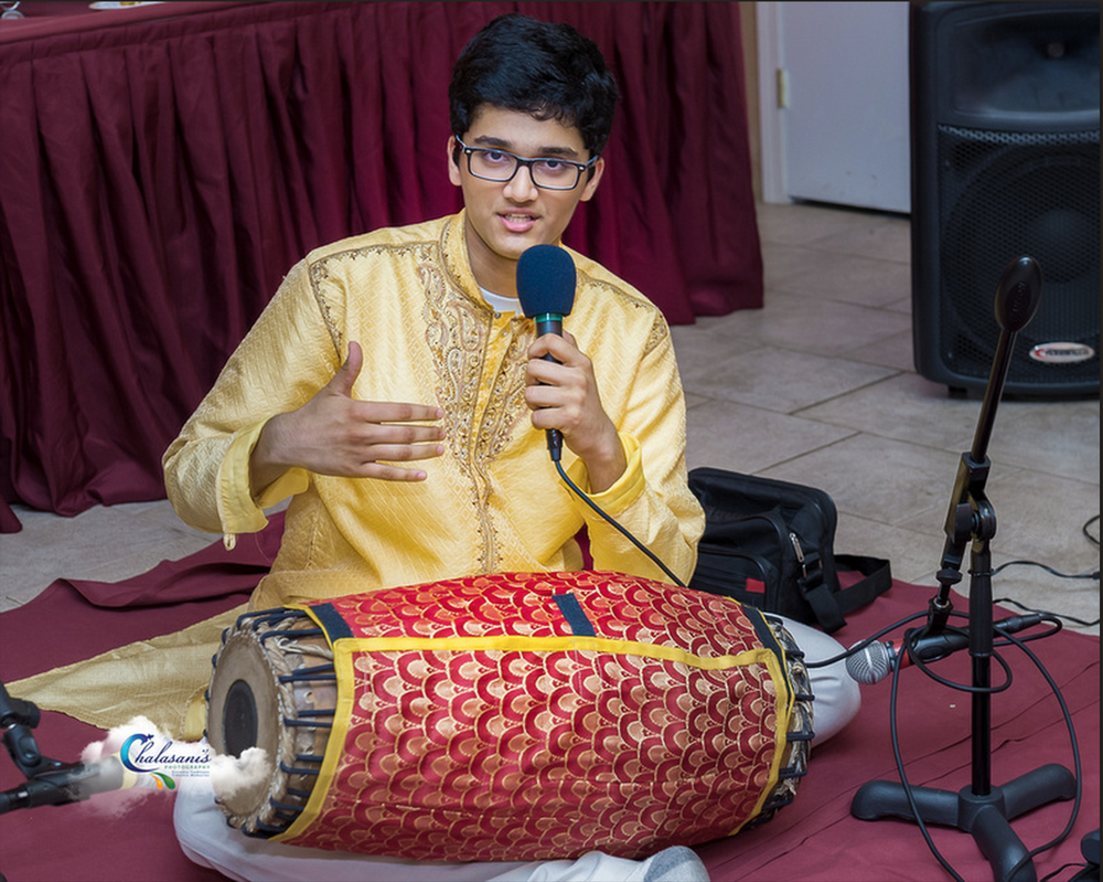 Speaking at a fundraiser concert in 2013 - over $15,000 raised for pediatric heart surgeries in India