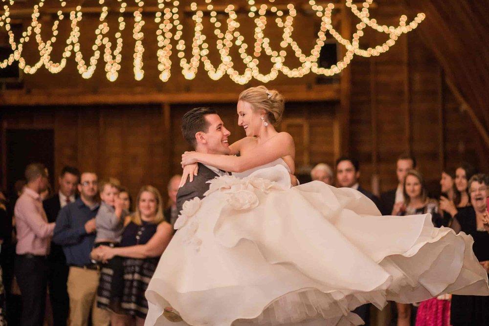 barn wedding bride and groom dancing under string lights.jpg