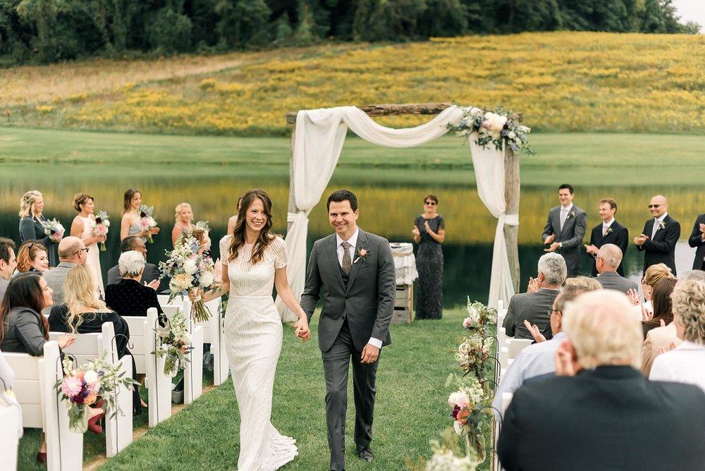 walking up aisle bride and groom final.jpg