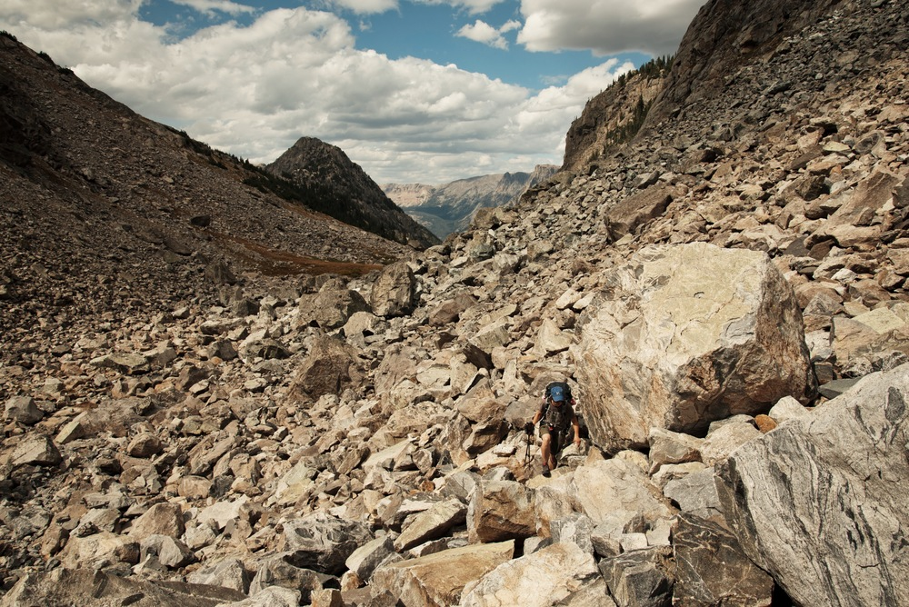 Scrambling over boulders to reach Shannon Pass while backpacking the Wind River Range in Wyoming