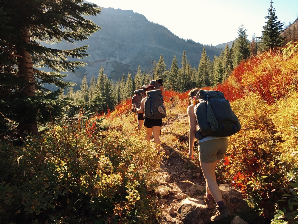 Women backpacking through the Montana wilderness at the WIld Sage Summit