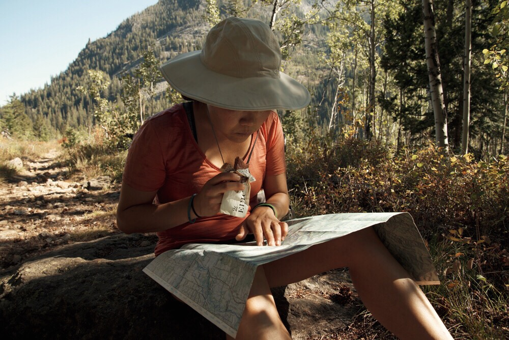Liz checking the topo map during our Epic snack break