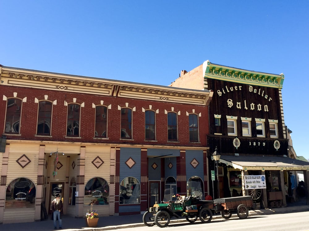 "The Silver Dollar Saloon, circa 1879 - dubbed ""The Best Wild West Saloon in America"" in a banner on the side of the building. I need to check out the inside next time!"