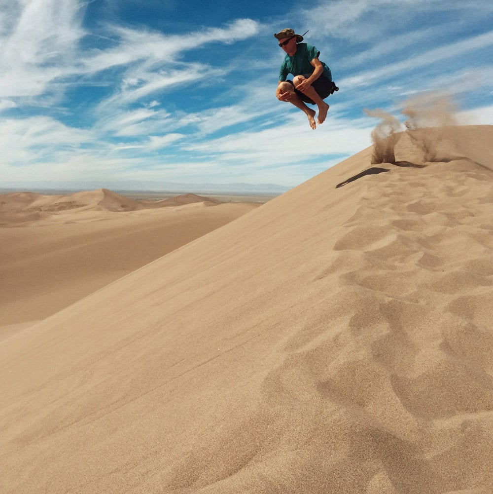 Cannonball into the sand at Great Sand Dunes National Park and Preserve.