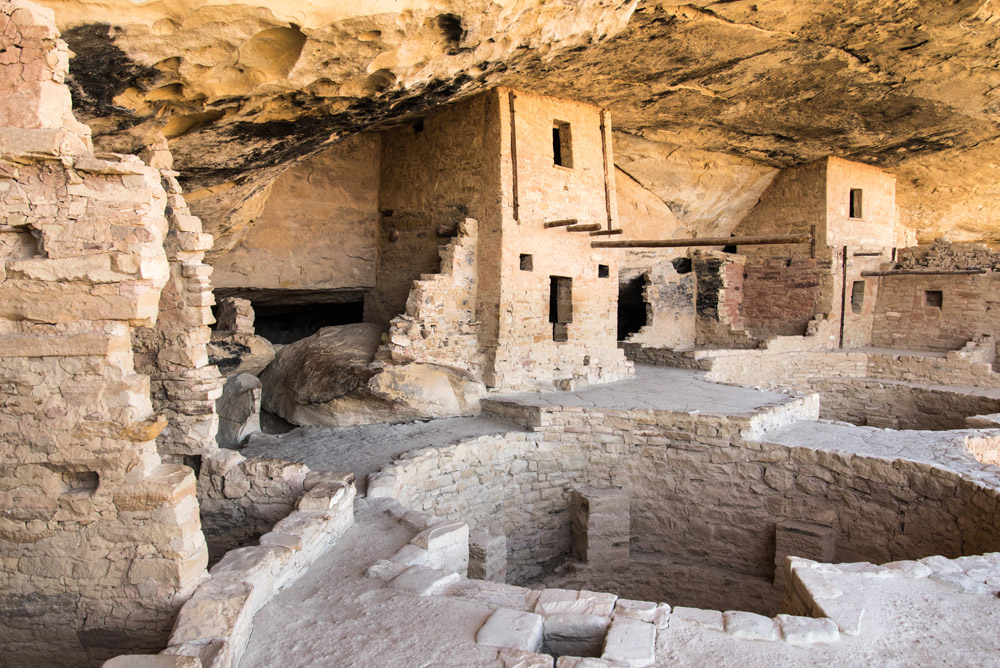 The view from inside Balcony House, a cliff dwelling that requires a steep climb up a ladder to enter. The round chambers are called kivas. Kivas are still included as central places within the community in many modern pueblos.