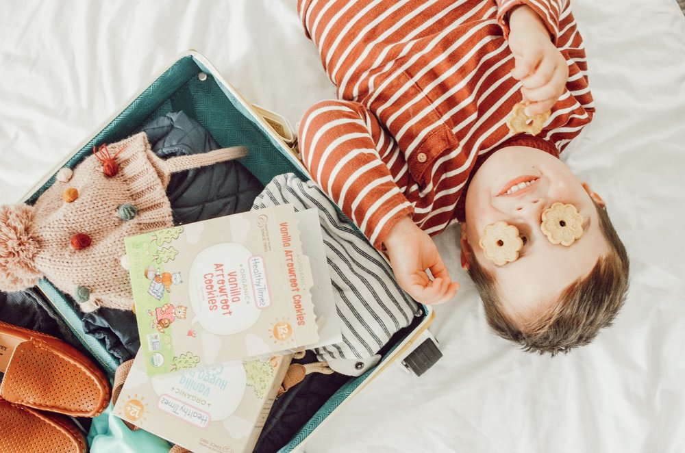 toddler boy eating healthy times snacks on bed
