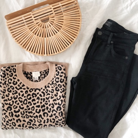 defining your style | Cute flatlay of leapord sweater and black jeans