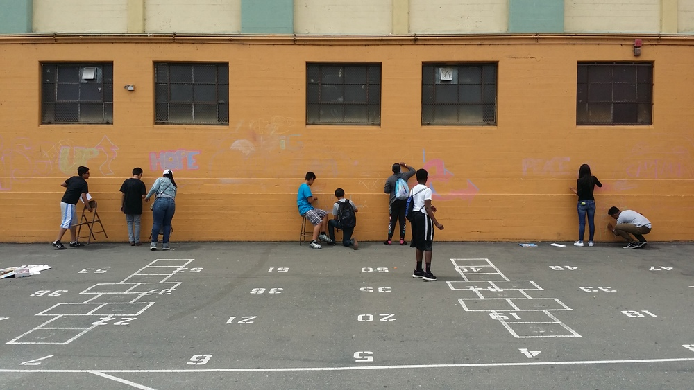 Chalk practice is a great temporary way for students to see their visions on a new surface.