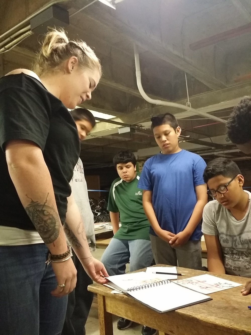 Tattoo artist Anna K. shared her sketchbook with the class and participated in live drawing demonstrations.