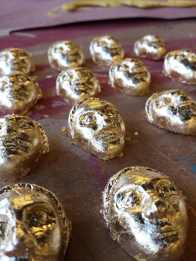 Gold faces by Lauren Coghlan
