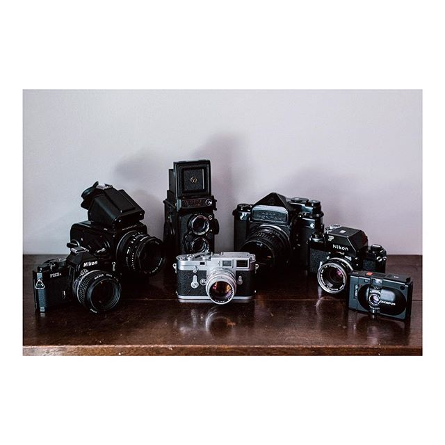 One of these things is not like the others -  I would like to take this opportunity to not only share my current stable of photographic machines, but also to share the fact that I am indeed still alive and (kinda sorta) active on Instagram. It's now 2019 and a lot has happened since I last posted, but before I get to that, we need to go back further. My New Year's resolution for 2018 was to post the images I make with my cameras, not the cameras themselves. Well, you can see how that turned out. I didn't post much. This year, I want to be honest with myself and admit that I like cameras as much, if not more than, the images I make. So 2019 will be the year for photos of cameras AND the photos they capture. Now that that's cleared up, I wanted announce that I have moved to Arkansas (bet you didn't see that one coming because neither did I) where I will be working at the @shilohmuseum as the photographic technician. My job will be handling the half a million historic images in their archives by copying/printing/cataloging/digitizing them. The best part (for me) is the fact that they understand the importance of film and it's longevity so the bulk of my time there will be spent in the darkroom, so yippee for me! By the way, tomorrow is my first day. On my birthday, no less. I also hope to start a separate Instagram account sometime in the future to share the historic images I will be working with, so stay tuned for that. Well, I think that's about it for now. If you're ever in NW Arkansas, come hang out! Hopefully it won't be another six months before I post again... #leica #nikon #pentax #olympus #hasselblad #yashica #cameracollection
