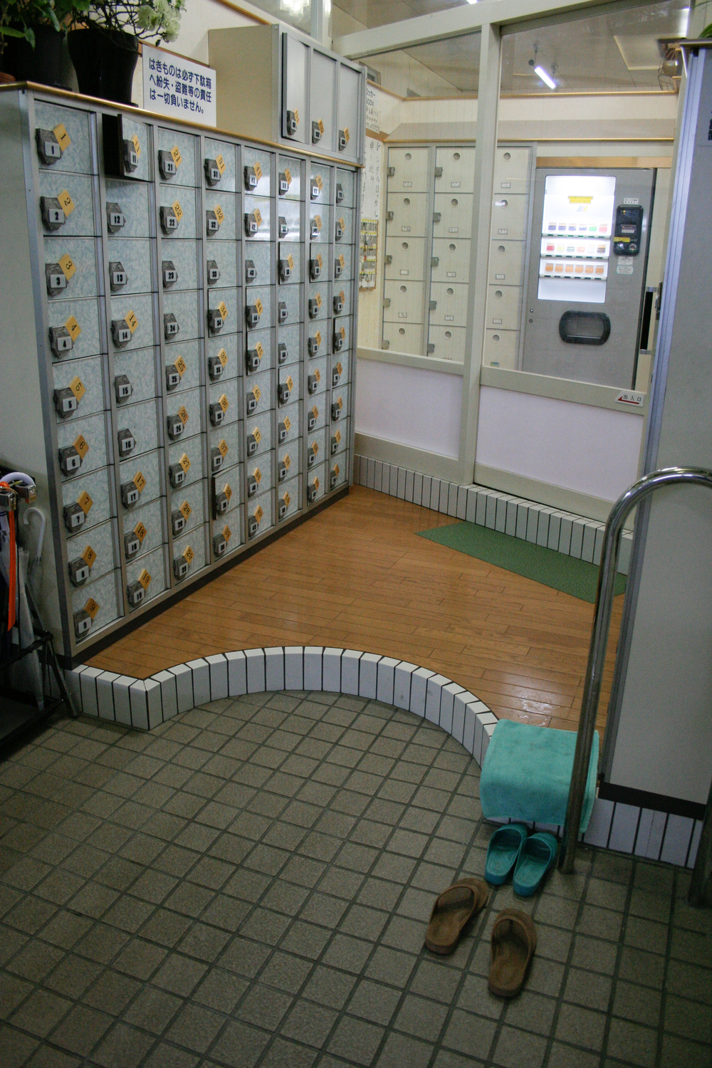 Shoe boxes at the entrance to a sento