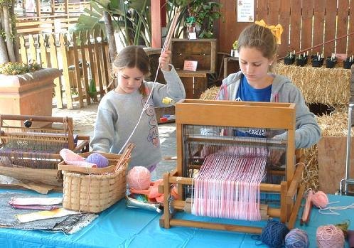 Brooke and Hayley, granddaughters of Wallie Weidhaas, demonstrate during the afternoon session. (See Gallery page for weaving by Brooke.)