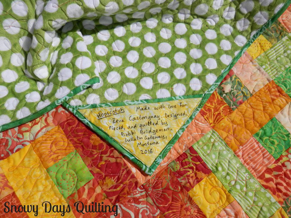 Hopscotch batik baby quilt