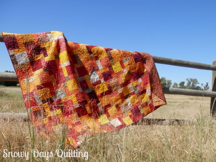 Linda's fiery hug batik fall disappearing nine patch quilt