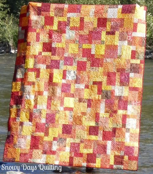 Linda's fiery hug batik disappearing nine patch quilt
