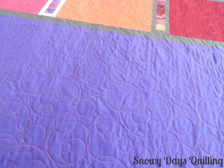 Quilting Design:  Champagne Bubbles by Kristin Hoftyzer  Quilt Maker:  Sharon Stoneberger  Quilt Pattern:  Roller Rink from Modern Patchwork by Elizabeth Hartman of  Oh Fransson .  Notes:  This is the back of the quilt. To see the front, check out  this blog post .  Fun Fact:  Champagne Bubbles was the  very first thing  I quilted with my longarm, and it's still one of my favorite designs.