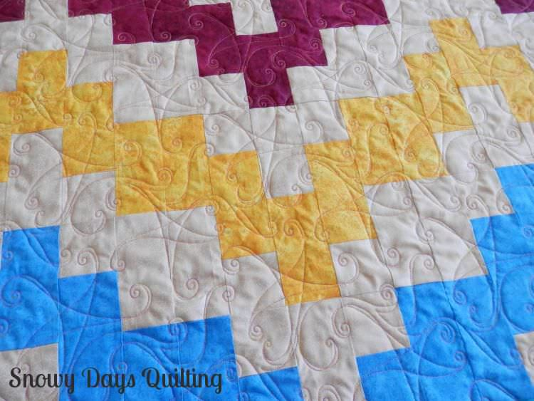 Quilting Design:  Swinging on a Star  Quilt Maker:  Barbara Beller  Quilt Pattern:  Belle Wave by Faith Jones of  Fresh Lemons Quilts