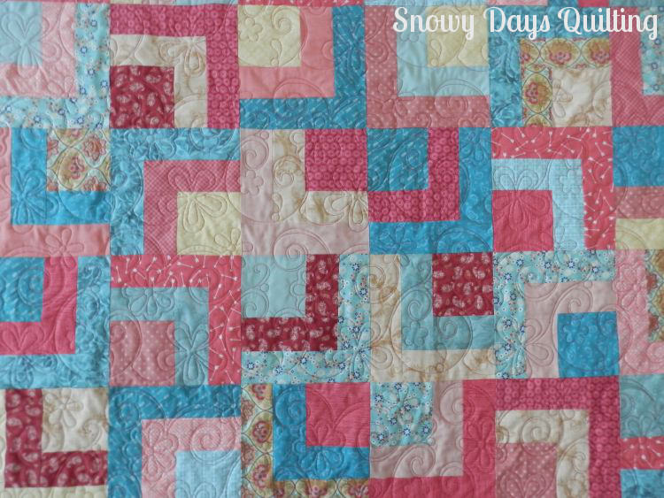 Quilting Design:  Excited by Anne Bright  Quilt Maker:  Colleen Kimm  Quilt Pattern:  Café Au Lait  Notes:  I haven't been able to find this pattern to credit the designer. If you know who the designer is, I would love to hear from you!