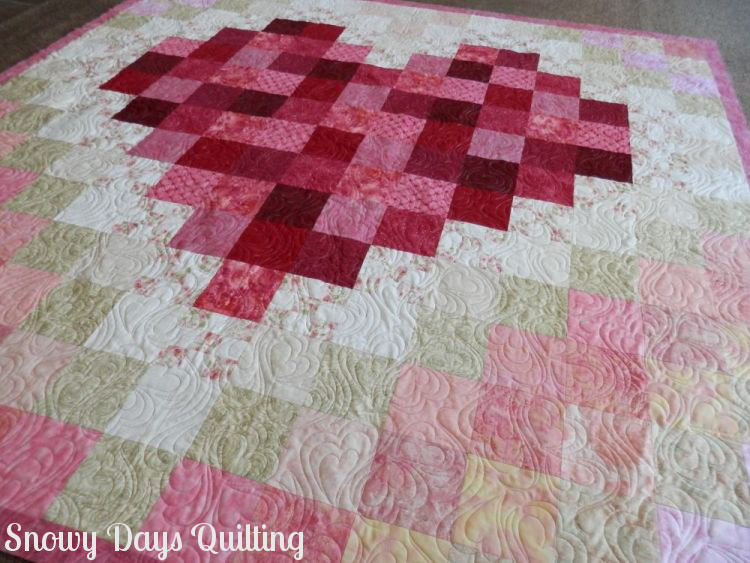 Quilting Design:  Heart to Heart by Patricia Ritter and Natalie Gorman  Quilt Maker:  Tese Shekitka  Quilt Pattern:  None  Notes:  Tese designed this quilt for a wedding, and she pulled all of the colors from the bride's bouquet. You can see more of this quilt  here .