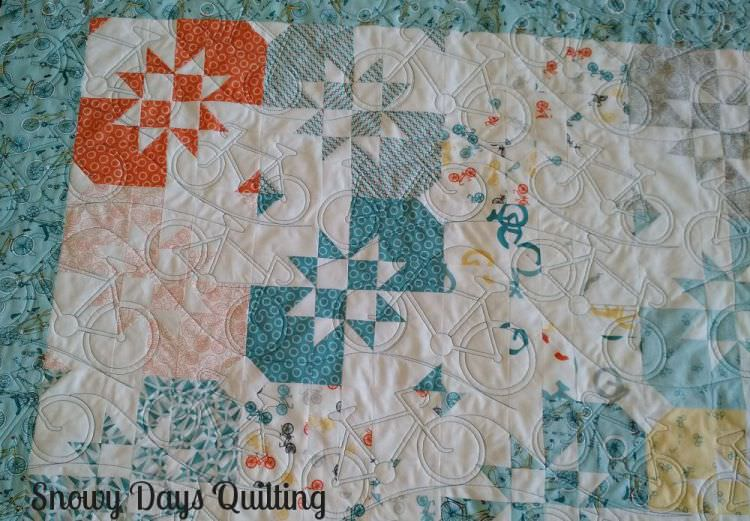 Quilting Design:  Bicycles and Hills by Marci Gore  Quilt Maker:  Bonnie Andes  Quilt Pattern:  Disappearing Hourglass by Jenny Doan of  Missouri Star Quilt Company   Notes:  If you would like to see more, I wrote all about this quilt  here .