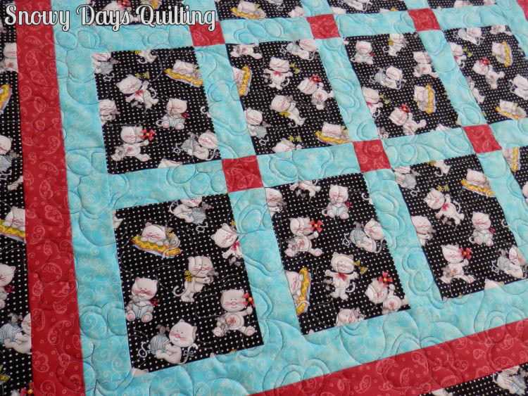 Quilting Design:  Paw Prints by Judy Vallely  Quilt Maker:  Cathie Heier  Quilt Pattern:  None  Notes:  The fabric in this quilt is Miss Kitty's Colors by Marie Cole for Henry Glass.