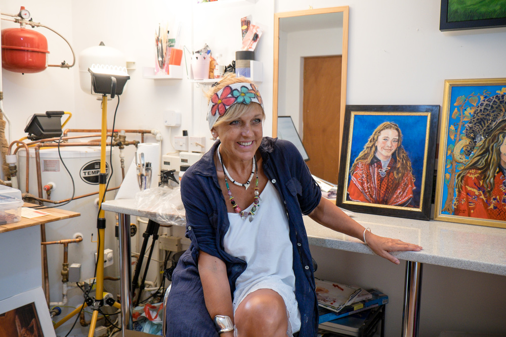 Jen in her Buckinghamshire Studio, with portrait of Taralynn.