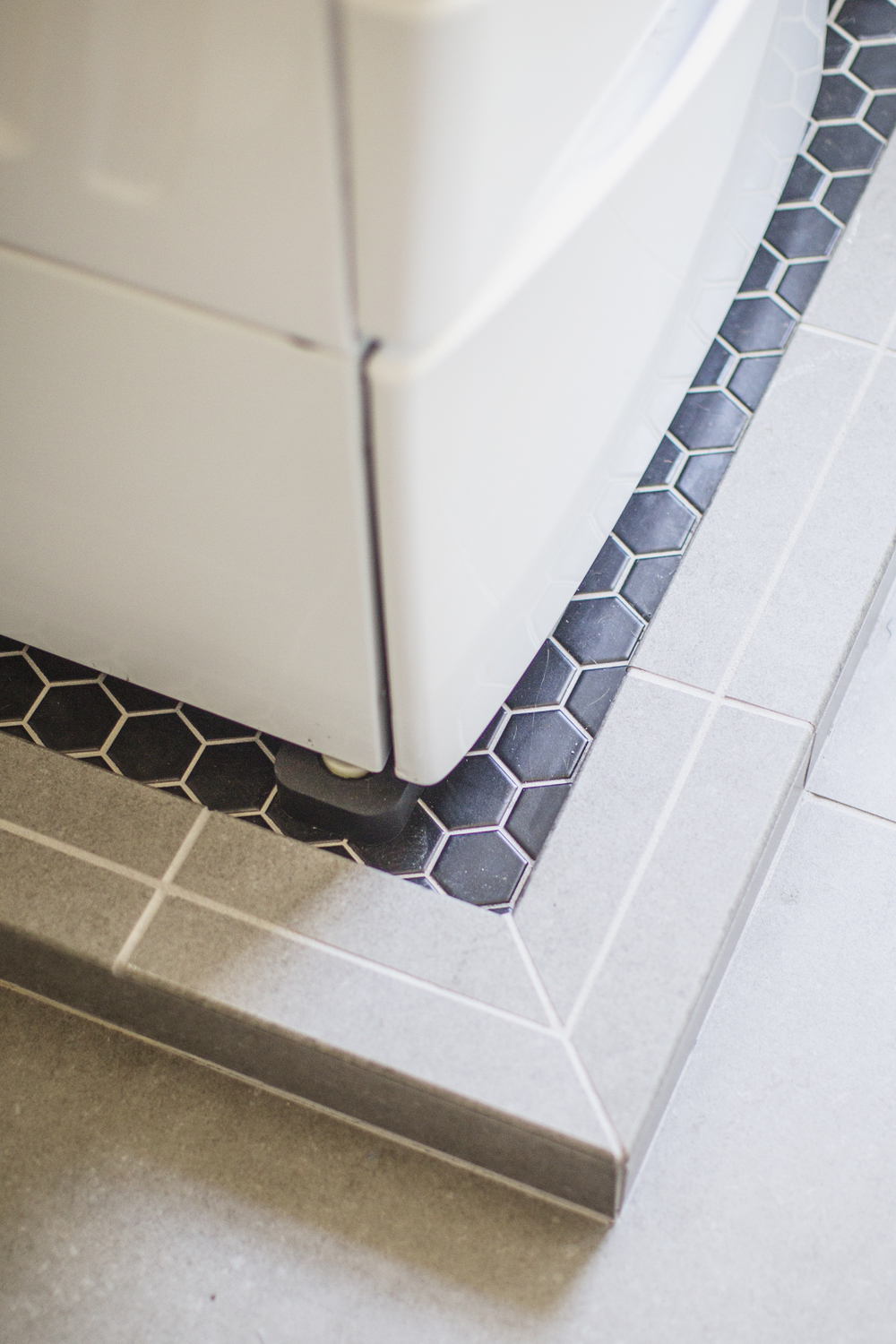 black beehive laundry room tile