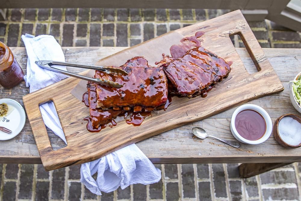 wooden feast board of BBQ ribs