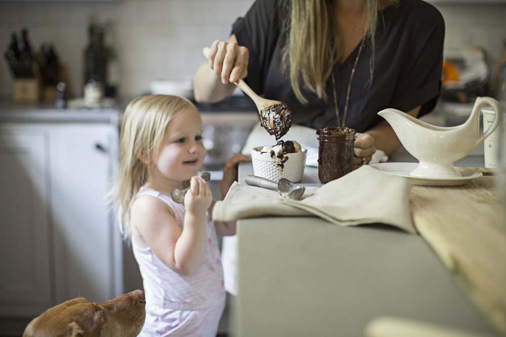 little girl making ice cream sundae