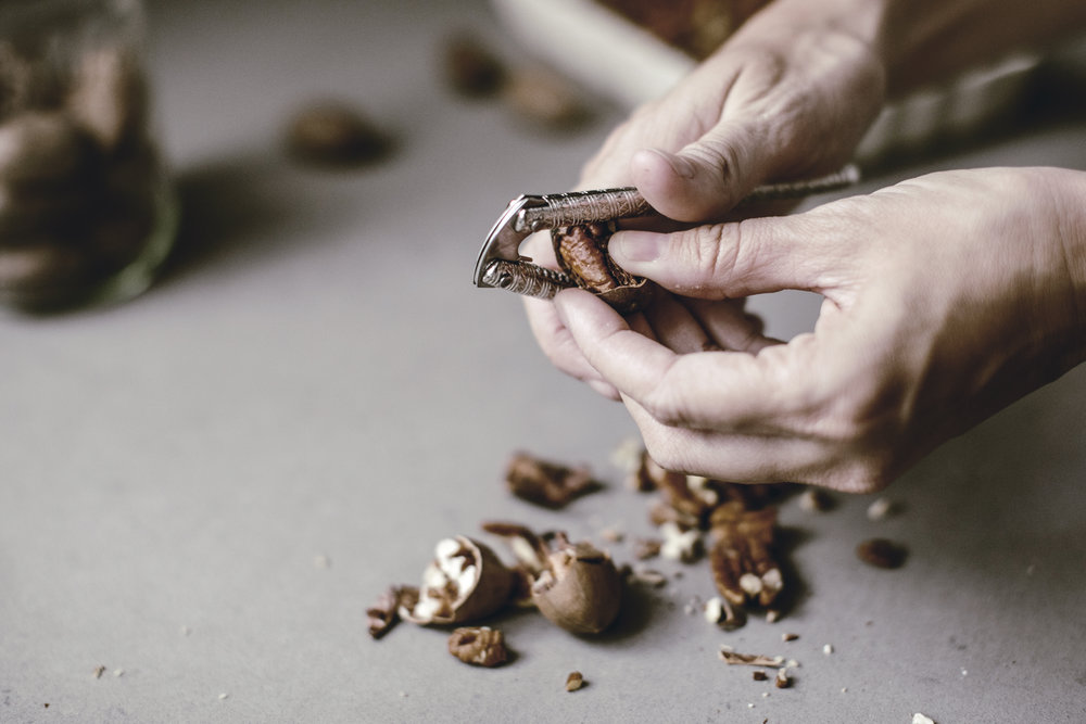 cracking pecans to make a pie