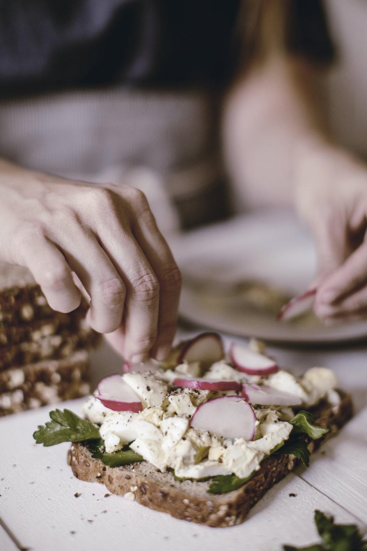 sliced radish garnish on an egg salad sandwich / heirloomed