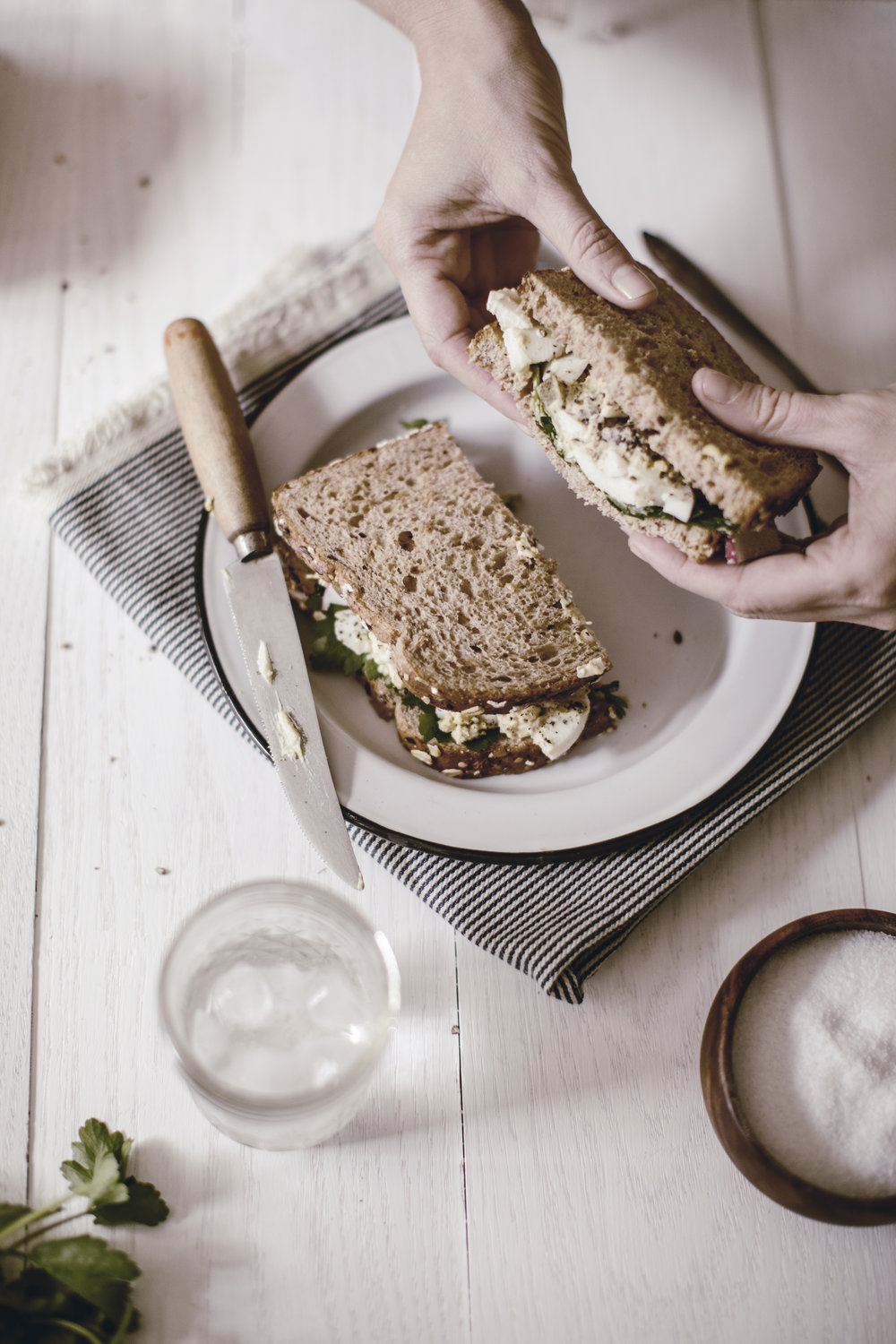 picnic sandwiches / egg salad sandwich on wheat / railroad stripe tea towel / heirloomed