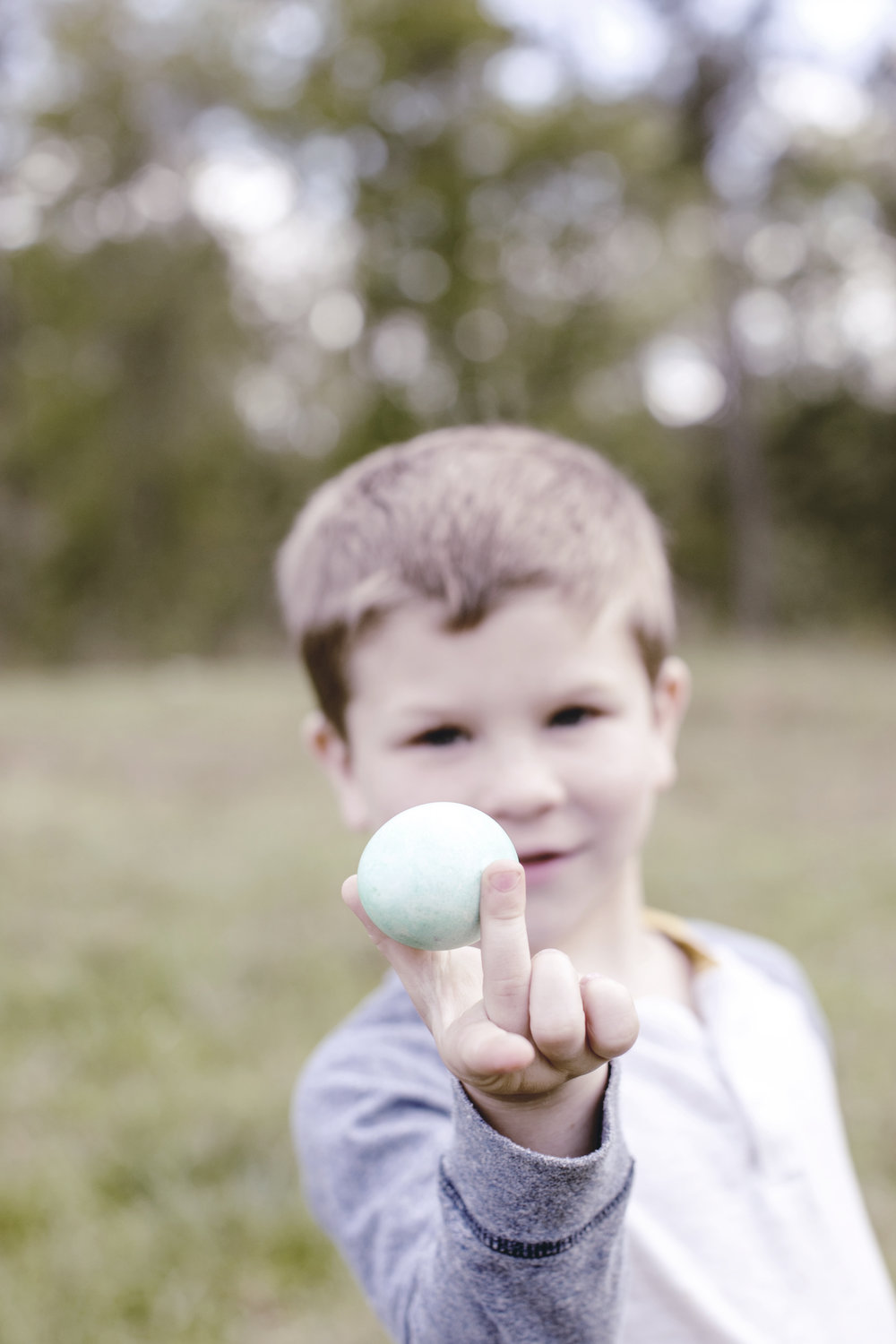 little boy holding an Easter egg / heirloomed