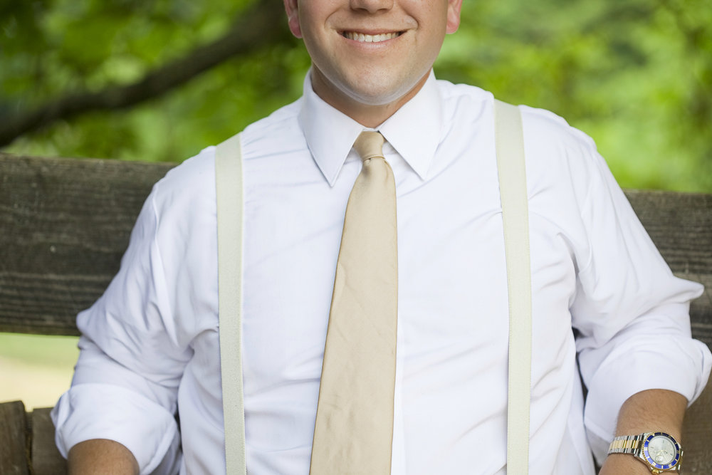 groom in suspenders / heirloomed