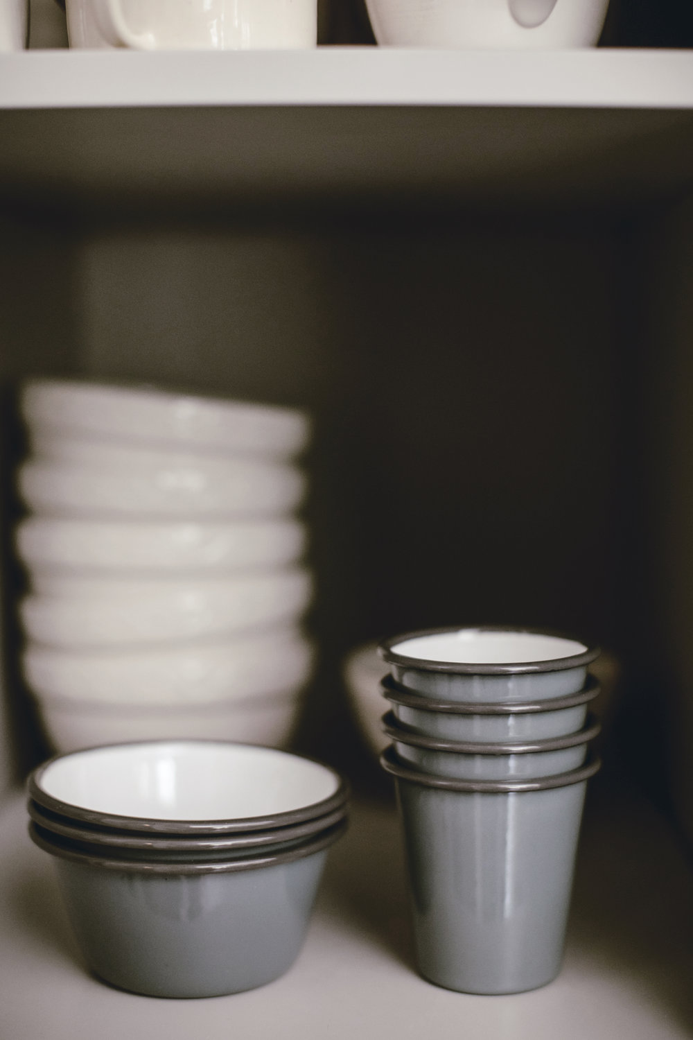 Stacks of dishes in open cabinet for kitchen tour and Falcon enamelware in pigeon grey / heirloomed