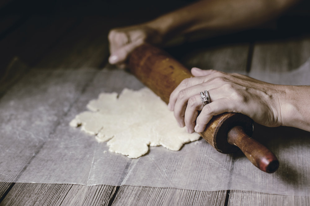 vintage rolling pin rolling out chilled dough / heirloomed